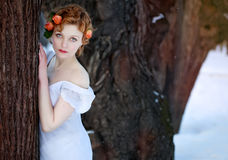WOman wearing only white dress in the winter  park or forest Stock Images