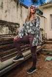 Woman Wearing White, Green, and Gray Floral Long-sleeved Top and Gray Pants royalty free stock photos