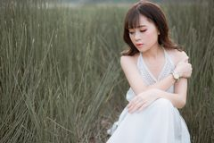 Woman Wearing White Halter Dress Surrounded By Grass Royalty Free Stock Images