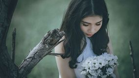 Woman Wearing White Halter Top Holding White Flower Bouquet Stock Photo