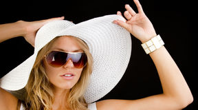 Woman wearing white hat Stock Photography