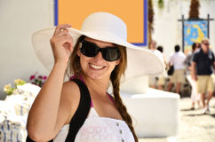 Woman wearing a white hat on her vacations. Woman in white dress and white hat, on her vacations in the Mikonos Island Stock Photos