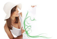 Woman wearing white hat  holding blank board. Royalty Free Stock Photos
