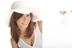 Woman wearing white hat  holding blank board. Stock Image