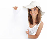Woman wearing white hat  holding blank board. Royalty Free Stock Photography