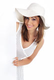 Woman wearing white hat  holding blank board. Stock Photography