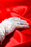 Woman wearing white lace glove  Stock Photo