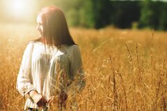 Woman Wearing White Long Sleeved Shirt Standing in Brown Grass Field Royalty Free Stock Images