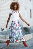 Woman Wearing White and Multicolored Floral V-neck Short-sleeved Maxi Dress royalty free stock images