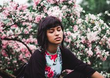 Woman Wearing White and Red Floral Crew-neck Shirt Near Pink Petaled Plant Stock Images