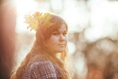 Woman Wearing White Red and Gray Plaid Shirt With Leaf Headdress Royalty Free Stock Photos