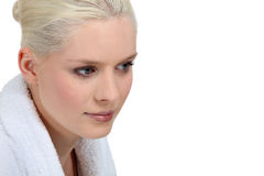 Woman wearing a white robe Stock Image