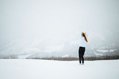 Woman Wearing White Shirt Standing on Snow during Day Time Stock Images