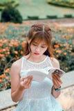 Woman Wearing White Sleeveless Dress Reading Book royalty free stock photos