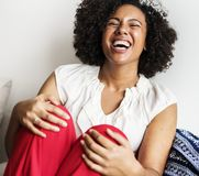 Woman Wearing White Sleeveless Top And Red Bottoms Laughing Royalty Free Stock Images