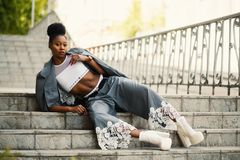 Woman Wearing White Sports Bra and Gray Pants Laying on Stairway Stock Images