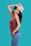 Woman wearing white straw hat on blue background Royalty Free Stock Images