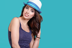 Woman wearing white straw hat on blue background Stock Photo