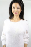Woman wearing a white sweater Stock Images
