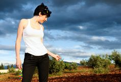 Woman wearing a white t shirt in the field Royalty Free Stock Photo