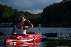Woman Wearing White Tank Top Riding on Red Kayak during Daytime Royalty Free Stock Images