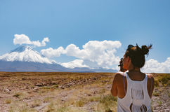 Woman Wearing White Tank Top While Taking Picture of the Mountain Under Blue Sky Stock Photos