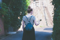 Woman Wearing White and Teal Stripe Shirt and Teal Drawstring Backpack during Daytime Stock Photography