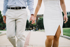 Woman Wearing White Tube Dress Holding Man's Hand Stock Image
