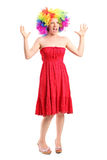 Woman wearing a wig and gesturing with hands Royalty Free Stock Photo