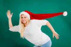 Woman wearing windblown long Santa hat Royalty Free Stock Photos