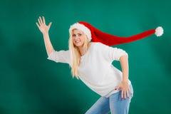 Woman wearing windblown long Santa hat Royalty Free Stock Photography