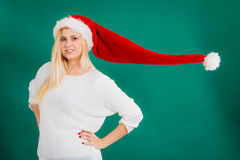 Woman wearing windblown santa hat Stock Photography