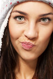 Woman wearing winter cap making puss face Royalty Free Stock Photos