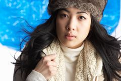Woman Wearing Winter Clothes In Studio Royalty Free Stock Image