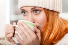 Woman wearing winter clothing drinking hot coffee Royalty Free Stock Photo