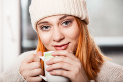Woman wearing winter clothing drinking hot coffee. Beautiful woman wearing winter clothing drinking hot coffee Stock Photos