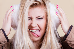 Woman wearing winter furry earmuffs having fun Stock Photo