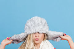Woman wearing winter furry warm hat Stock Images