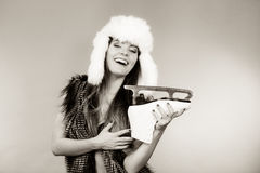 Woman wearing winter hat holding ice skate Stock Photos
