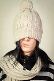 Woman wearing a winter hat over his eyes Royalty Free Stock Photography