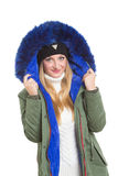 Woman wearing winter jacket scarf and cap Stock Images