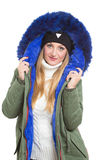 Woman wearing winter jacket scarf and cap Stock Photo