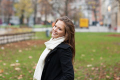 Woman Wearing Winter Jacket Scarf Standing In Park Royalty Free Stock Photo