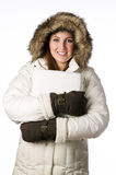 Woman wearing a winter parka Stock Photography
