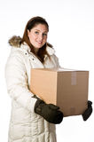 Woman wearing a winter parka holding a box Stock Photos