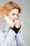 Woman wearing winter warm furry jacket Royalty Free Stock Photo