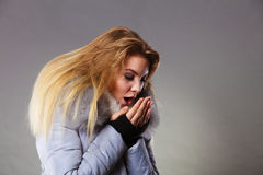Woman wearing winter warm furry jacket Royalty Free Stock Photos