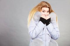Woman wearing winter warm furry jacket Stock Image