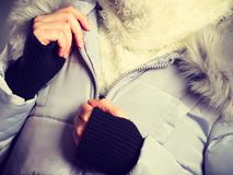 Woman wearing winter warm furry jacket. Seasonal fashion, clothes and clothing concept. Woman wearing light winter warm furry coat perfect for cold days royalty free stock photos