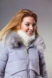 Woman wearing winter warm furry jacket Royalty Free Stock Photos